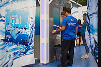 """JPMorgan Chase promotes its refillable debit card, """"Liquid"""" at the Harlem Week street fair on West 135th Street in Harlem in New York on Sunday, August 19, 2012. (© Frances M. Roberts)"""