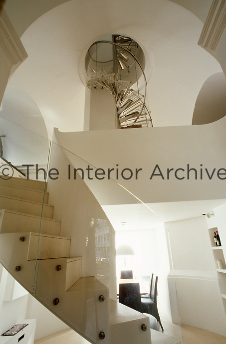 The spiral staircase is like a sculpture that winds its way up the seven storeys of the tower