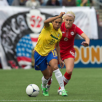 Brazilian player Marta (10) dribbles as Canadian player Kaylyn Kyle (6) defends. In an international friendly, Canada defeated Brasil, 2-1, at Gillette Stadium on March 24, 2012.