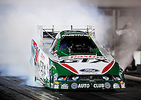 Sept. 17, 2010; Concord, NC, USA; NHRA funny car driver Ashley Force Hood does a burnout during qualifying for the O'Reilly Auto Parts NHRA Nationals at zMax Dragway. Mandatory Credit: Mark J. Rebilas/