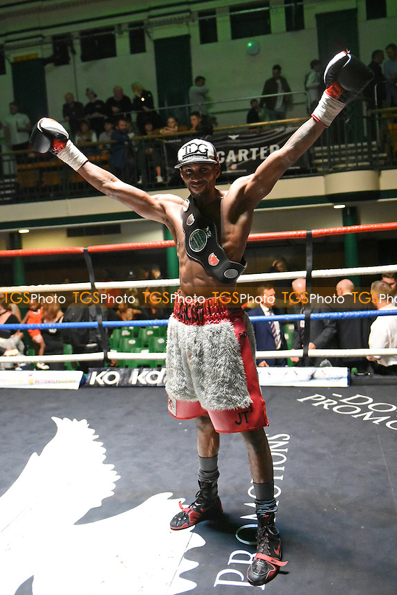 Asinia Byfield (grey/red shorts) defeats Erick Ochieng during a Boxing Show at York Hall on 15th October 2016