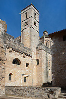Low angle view of the eastern facade of the Chapter and the Dormitory in Monestir de Santes Creus, Aiguamurcia, Catalonia, Spain, pictured on May 21, 2006, in the morning. The Cistercian Reial Monestir Santa Maria de Santes Creus and its church were built between 1174 and 1225. In the 13th century parts of the abbey and the cloister were converted in Gothic style by James II of Aragon who also added the dome to the church, which can be seen in the background. The tower marks the stairs to the Chapter and Dormitory. Picture by Manuel Cohen.