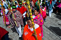 Ecuadorean indigenous people take part in the religious parade within the Corpus Christi festival in Pujilí, Ecuador, 1 June 2013. Every year in June, thousands of people gather in a small town of Pujili, high in the Andes, to celebrate the Catholic feast of Corpus Christi. Introduced originally during the Spanish conquest of South America, this celebration merges Catholic rituals of Holy Communion with the traditional Andean harvest and sun festivities (Inti, the Inca sun god). Women dancers perform wearing brightly colored costumes while men dancers wear chest ornaments and heavy elaborate headdresses adorned with mirrors, jewelry, or natural items (shells). Being a dancer in the Corpus Christi ceremonial parade (El Danzante) is considered an honour and a privilege by the indigenous people in Ecuador.