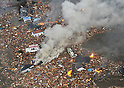Houses are swept up by a tsunami near Sendai Airport after an earthquake on March 11, 2011. A huge M8.9 earthquake hit Japan on Friday 11th March, 2011 followed by a giant tsunami causing death and destruction