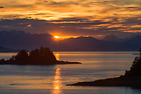 Sunset behind the Chilkat mountains, Franklin Island in the Lynn Canal, Southeast, Alaska