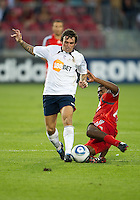 21 July 2010:   Bolton Wanderers midfielder Mark Davies No. 16 and Toronto FC midfielder Joseph Nane No. 15 in action during the Carlsberg Cup game between the Bolton Wanderers and Toronto FC at BMO Field in Toronto..Bolton Wanderers FC  won on penalties.
