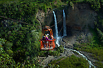 """A family zip lines together across the Rio Pastaza valley in the Andean highlands of Banos .  Banos has become an adventure destination for foreigners and Ecuadorians, and is known as the """"Gateway to the Amazon"""" because of its location on the Pastaza River in the Amazon River Basin."""