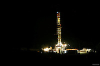 A new natural gas drilling rig runs all night, operated by Chief Oil &amp; Gas, behind the barn on the Kerr family farm in Hop Bottom, PA, near Dimock, where drinking water wells became contaminated with methane and other chemicals.<br />