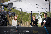 Five days after Election Day a new Government is formed involving the Conservative Party and The Liberal Democratic Party. Photos taken at College Green (Abingdon Street Gardens) in Westminster, London. Photo shows Caroline Lucas, Britain's first Green MP, being interviewed by Sky News.