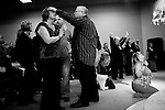 Senior Pastor Rich Oliver, center, puts his hand on the head of a member of &quot;The Family&quot; church during Sunday services in Roseville, Calif., January 16, 2011..CREDIT: Max Whittaker for The Wall Street Journal.FORCHURCH