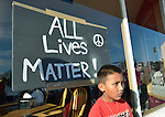 A boy stands in front of a sign during a February 14 2015 march and rally in Pasco, Washington, that demanded justice for the killing of Antonio Zambrano Montes by three Pasco police officers on February 10.