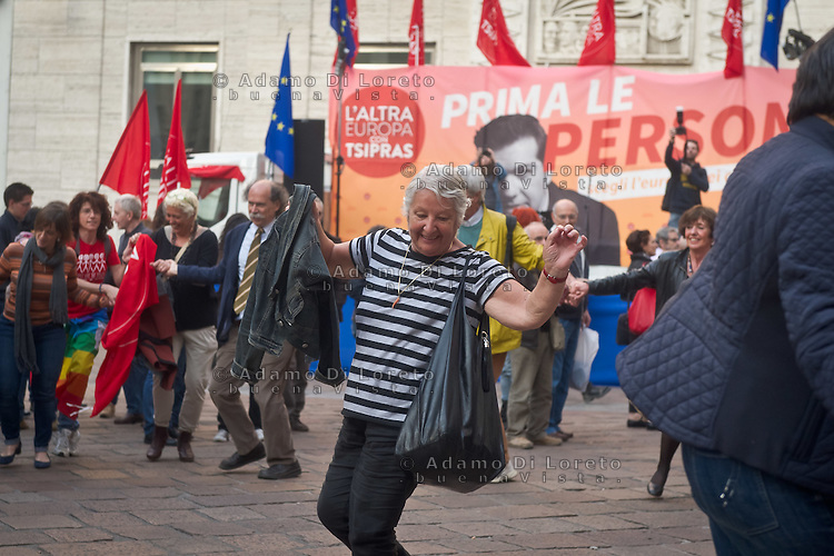 the people dance the Sirtaki music during the presentation of Italy's Tsipras List in Piazza Affari (Milan Stock Exchange) , on April 23, 2014. Photo: Adamo Di Loreto/BuenaVista*Photo