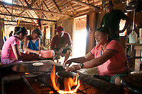 Santa Theresa, Moho River, Belize, April 2012. cooking with Pedro's wife and children at his home. The native Maya people of the village of Santa Theresa still live a traditional lifestyle in their wooden thatch roofed homes without electricity. Santa Theresa is home to Pedro and Mario our Mayan river kayaking guides, and put in point for paddling the Moho river. The Moho river has many drop pools, waterfalls and rapids, but it also has quiet stretches. The river runs through the rainforest where we camp for the night. Photo by Frits Meyst/Adventure4ever.com