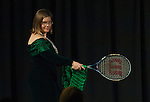 Julie Suhr, professor and director of clinical training in the department of Psychology, shows off her tennis racket and home-made scarf during the formal portion of the Ava Nichols Faculty Pageant in Baker Ballroom on Wednesday, February 25.