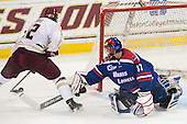 Kevin Hayes (BC - 12), Connor Hellebuyck (UML - 37) - The Boston College Eagles defeated the visiting University of Massachusetts Lowell River Hawks 3-0 on Friday, February 21, 2014, at Kelley Rink in Conte Forum in Chestnut Hill, Massachusetts.