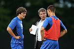 20 September 2013: Duke head coach John Kerr talks with Zach Mathers (left) and Jimmy Doll (right). The Duke University Blue Devils hosted the Syracuse University Orangemen at Koskinen Stadium in Durham, NC in a 2013 NCAA Division I Men's Soccer match. Syracuse won the game 2-1.