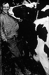 Joe Schwartzbeck of Union Bridge, MD gets a congratulatory kiss from one of his prized Holsteins after being named the Outstanding Young Farmer of Maryland in 1972.
