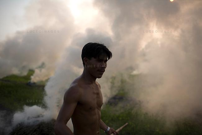 A Vietnamese man tends to his fields in Tay Ninh, Vietnam.