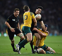Nehe Milner-Skudder of New Zealand is double-tackled by Bernard Foley and Dean Mumm of Australia. Rugby World Cup Final between New Zealand and Australia on October 31, 2015 at Twickenham Stadium in London, England. Photo by: Patrick Khachfe / Onside Images