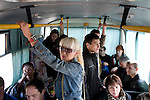 Patients in a rehabilitation program for heroin addiction operated by the NGO Rosa Vetrov (standing) ride the bus in Kazan, Russia, on Wednesday, September 26, 2007. The dozen patients in the free three-month program take a weekly field trip to a nearby lake, where they learn play soccer, have group therapy sessions, and generally learn how to relax and have fun without using drugs.