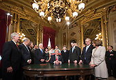 United States President Donald Trump is joined by the Congressional leadership and his family as he formally signs his cabinet nominations into law, in the President's Room of the Senate, at the Capitol in Washington, Friday, Jan. 20, 2017. <br /> Credit: J. Scott Applewhite / Pool via CNP