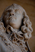 Palace of Versailles. Head close-up of a statue of a man.