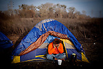 Sergio sits in his tent at the SafeGround camp in Sacramento, Calif., January 15, 2011.