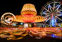 """Children scream as they ride the """"Sizzler"""" the """"Hotshot"""" and the Ferris wheel at the Central Alabama Fair sponsored by the Lions Club on Thursday night."""