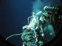 Equipment from a submersible photographing and collecting near a Hydrothermal Vent and Black Smoker.