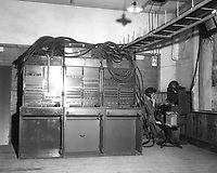 Three BD-110A switchboards on left and one BD-96 on extreme right being operated by Pfc. James Grahn of Co. B, 71st Sig. Svc. Bn., Pusan, Korea.  August 1, 1950.  Cpl. Crowe. (Army)<br /> NARA FILE #:  111-SC-344946<br /> WAR &amp; CONFLICT BOOK #:  1408