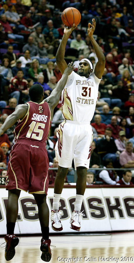 TALLAHASSEE, FL 2/14/10-FSU-BC BB10 CH04-Florida State's Chris Singleton shoots over Boston College's Rakim Sanders during first half action Sunday at the Donald L. Tucker Center in Tallahassee. The Seminoles beat the Eagles 62-47...COLIN HACKLEY PHOTO
