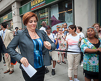 "NYC mayoral candidate and City Council Speak Christine Quinn arrives at Fairway supermarket in the Chelsea neighborhood of New York on its grand opening day, Wednesday, July 24, 2013. The store is the fifth in Manhattan and is an epicurean delight carrying olive oils, cheeses, sushi and their famous deli department. The Chelsea location puts the store in the middle of ""supermarket-ville"" with Whole Foods, Gristedes and Trader Joe's all having locations in the immediate vicinity.(© Richard B. Levine)"