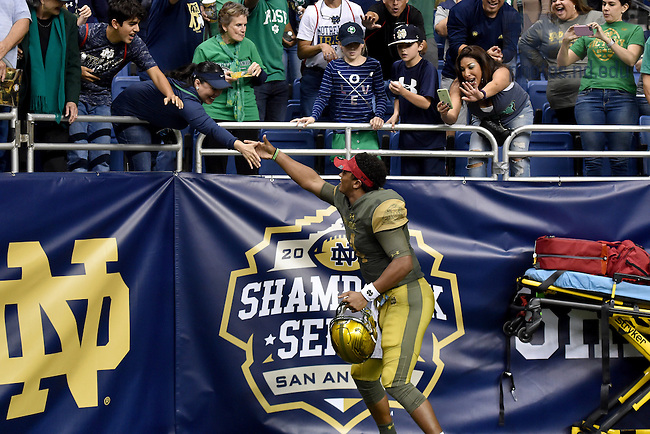 November 12, 2016; Irish quarterback DeShone Kizer (14) greets fans after the 2016 Shamrock Series game at the Alamodome. Notre Dame defeated Army 44-6. (Photo by Matt Cashore)