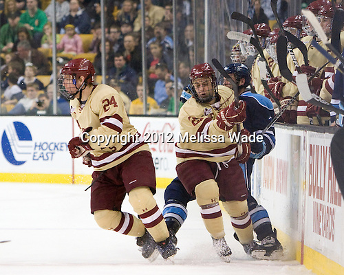 Bill Arnold (BC - 24), Steven Whitney (BC - 21) - The Boston College Eagles defeated the University of Maine Black Bears 4-1 to win the 2012 Hockey East championship on Saturday, March 17, 2012, at TD Garden in Boston, Massachusetts.