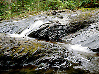 WATERFALL<br /> Mountain stream<br /> Channel erosion: rocks in turbulent stream bed are shaped by abrasion -cavitation &amp; potholes. A waterfall has kinetic energy at the top which converts to kinetic energy as it falls.