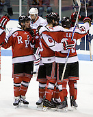 The Engineers celebrate Chase Polacek's (RPI - 21) goal which tied the game at the 17:55 mark of the second period. - The visiting Rensselaer Polytechnic Institute Engineers tied their host, the Northeastern University Huskies, 2-2 (OT) on Friday, October 15, 2010, at Matthews Arena in Boston, MA.