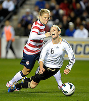 US forward Amy Rodriguez (8) trips up Germany's Simone Laudehr (6).  The U.S. Women's National Team tied Germany 1-1 in a friendly at Toyota Park in Bridgeview, IL on October 20, 2012.