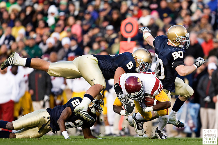 10/17/09 - South Bend, IN:  USC tight end Anthony McCoy gets tackled by the Notre Dame secondary during their game at Notre Dame Stadium on Saturday.  USC won the game 34-27 to extend its win streak over Notre Dame to 8 games.  Photo by Christopher McGuire.