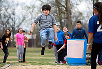 NWA Democrat-Gazette/JASON IVESTER<br /> Lex Williams, Kirksey Middel School sixth-grader, participates in the long jump Thursday, March 16, 2017, during Greek Day at the Rogers school. Sixth-graders have been studying ancient Greece in their World History class and competed in both athletic and intellectual competitions during the day in the Kirksey Olympics. Gold, silver and bronze awards will be handed out today (FRIDAY) from the events.