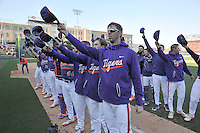 Clemson players sing the alma mater for fans in the stands following the Reedy River Rivalry game against the South Carolina Gamecocks  on Saturday, March 4, 2017, at Fluor Field at the West End in Greenville, South Carolina. Clemson won, 8-7. (Tom Priddy/Four Seam Images)