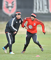 Forward Carlos Ruiz (20) with assistant head coach Chad Ashton of D.C. United during the pre-season practice at the auxiliary fields at RFK Stadium, Thursday February 28, 2013.