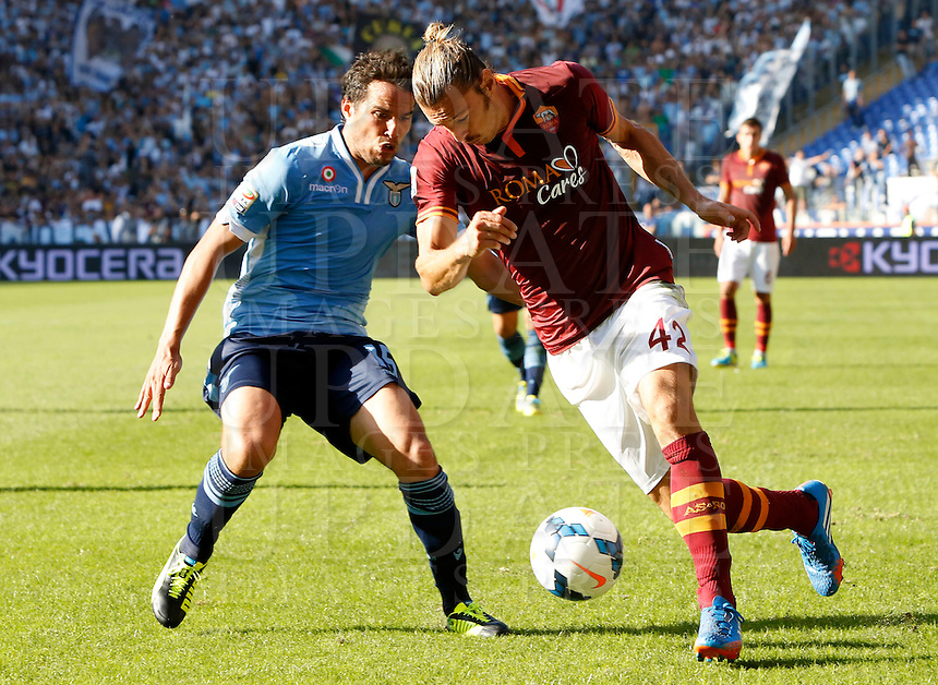 Calcio, Serie A: Roma vs Lazio. Roma, stadio Olimpico, 22 settembre 2013.<br /> AS Roma defender Federico Balzaretti, right, is challenged by Lazio midfielder Alvaro Gonzalez, of Uruguay, during the Italian Serie A football match between AS Roma and Lazio, at Rome's Olympic stadium, 22 September 2013.<br /> UPDATE IMAGES PRESS/Riccardo De Luca