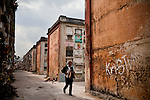 An accordianist walks through Cementario General, in Guatemala City , Thursday, March 22, 2012.