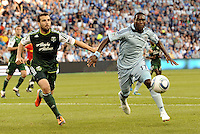 C.J Sapong (17) forward Sporting KC and Mike Chabala (4) defender Portland Timbers chase down the ball..... Sporting Kansas City defeated Portland Timbers 3-1 at LIVESTRONG Sporting Park, Kansas City, Kansas.
