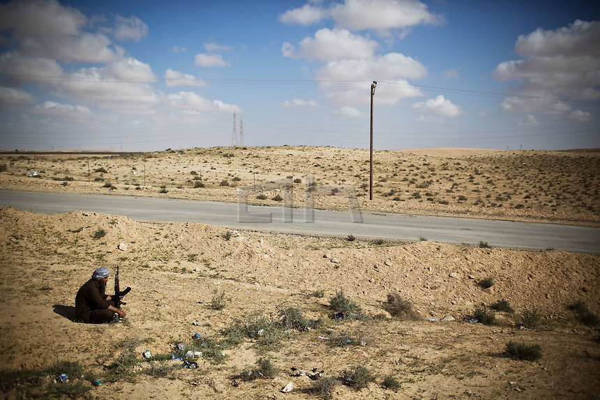 Libya 1st April 2011..Benghazi based Anti Gadaffi freedom fighters 10km outside the recaptured town of Brega and on route to the ever moving frontline bomb rebel 'Shabaab' freedom fighters despite being bombed by Nato aircraft..Gadaffi's forces regaining  ground close to Aljabya for the sixth time in two weeks. This after the coalition forces handed over the defensive action to Nato who has ceased bombing targets that were seen as harmful to civilians in Libya.