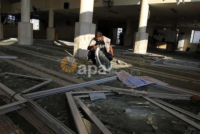 A Palestinian man surveys the damage in Bin Zayed mosque after an Israeli air strike in Gaza August 19, 2011. Israeli aircraft struck Hamas security installations in Gaza on Friday, killing at least one Palestinian, in further retaliation for attacks along the Egyptian border in which eight Israelis died. Photo by Mohammed Asad
