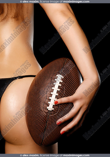 Sexy young woman with a football in her hand