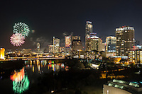 Austin's New Years Eve Fireworks celebration paint the beautiful downtown skyline and Lady Bird Lake, Austin, Texas.