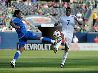 El Salvador's Victor Turcios and Cuba's Marcel Hernandez battle for a loose ball.  El Salvador defeated Cuba 6-1 at the 2011 CONCACAF Gold Cup at Soldier Field in Chicago, IL on June 12, 2011.