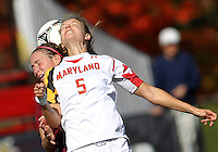 COLLEGE PARK, MD - OCTOBER 21, 2012:  Kristen Schmidbauer (5) of the University of Maryland stretches back to head the ball against  Florida State during an ACC women's match at Ludwig Field in College Park, MD. on October 21. Florida won 1-0.